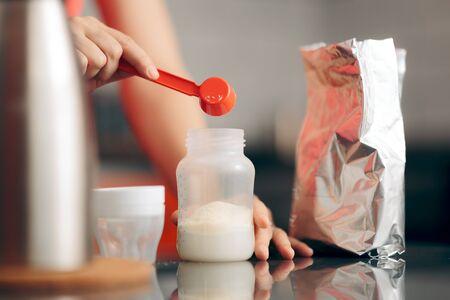 Mom Preparing Formula in Baby Bottle at Home