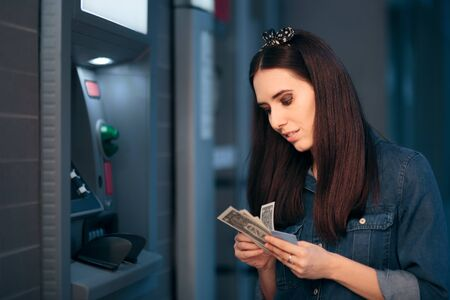 Woman Courting Money in Front of ATM Machine