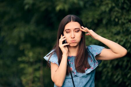 Worried Woman Talking At the Phone Outdoors
