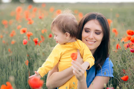 Happy Mom and Daughter in Beautiful Field of Poppies