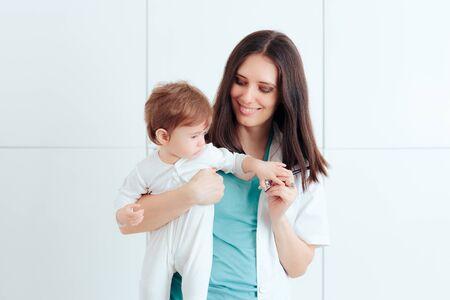 Female Pediatrician Holding Happy Baby for Examination