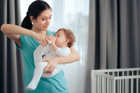 Stressed Mom Holding Naughty Active Baby Feeling Tired