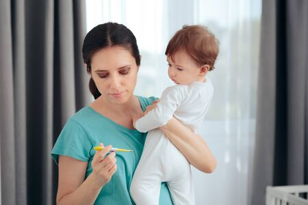 Worried Mom Holding Thermometer Checking Baby Temperature