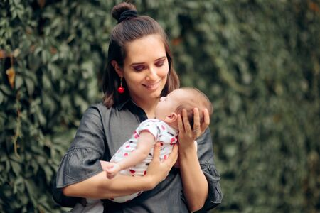 Portrait of Mother and Newborn Baby in Summertime