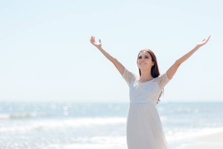 Happy Woman with Raised Arms By the Sea Standard-Bild