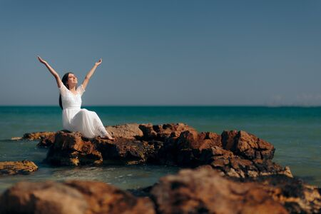 Happy Woman with Raised Arms By the Sea
