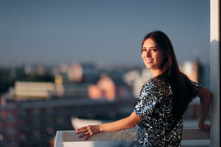Woman Wearing Sequined Top Standing in Balcony Admiring Sunrise
