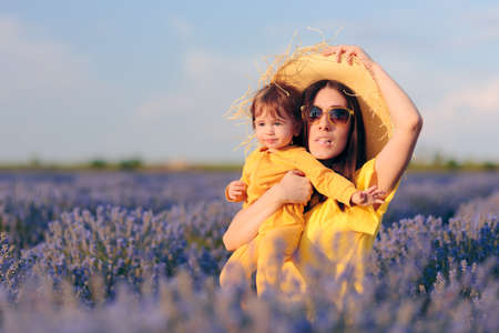 Funny Mom and Baby Sitting in Lavender Field