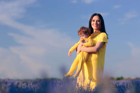 Mother with Baby in Beautiful Lavender Field