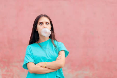 Funny Woman Blowing Bubble with Chewing Gum Stok Fotoğraf
