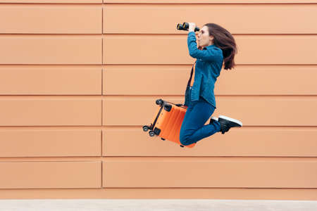 Excited Travel Woman Holding Binoculars and Suitcase Banco de Imagens