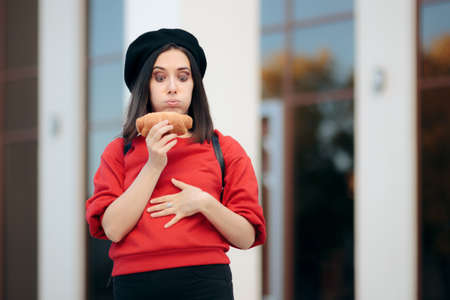 Woman Holding a Croissant Feeling Hungry