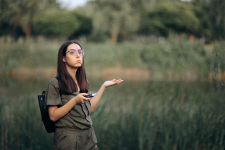 Funny Woman Lost in Nature Looking at Smartphone