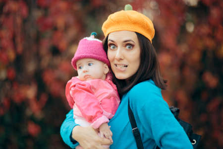 Portrait of a Cute Mother and Child Wearing Knitted Hats