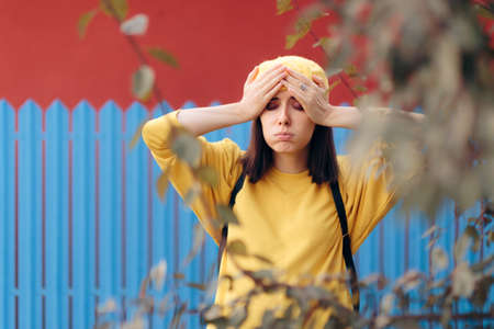 Unhappy Desperate Woman Wearing Yellow Beret
