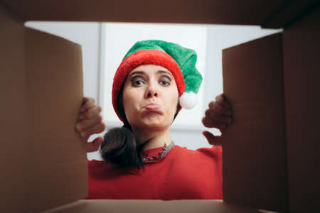 Disappointed Christmas Woman Looking Inside Cardboard Gift Box