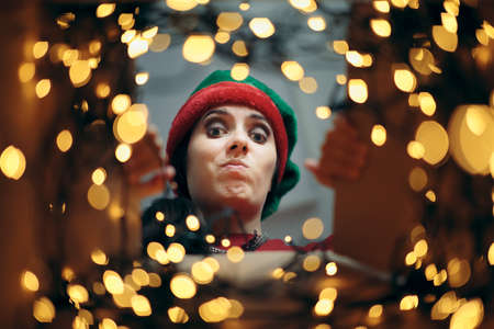 Disappointed Christmas Woman Looking Inside Cardboard Gift
