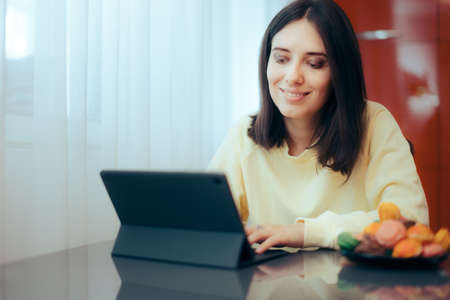 Woman with Pc Tablet Working from Home in Her Own Kitchen