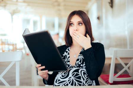 Nauseated Pregnant Woman Looking in a Food Menu Standard-Bild