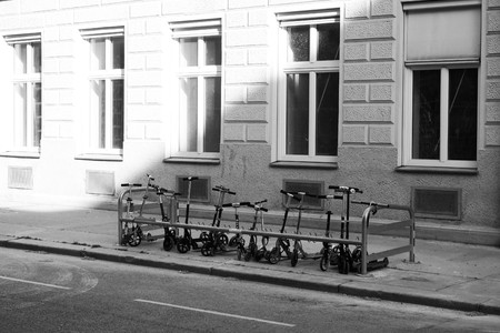 Scooters in front of scool in Vienna