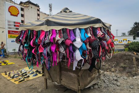 Nairobi, Kenya - September 13, 2017: Market stand on the streets of Nairobi with loads of bras hanging down