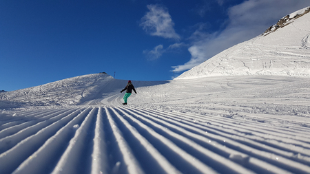 Popular winter sport scene with fresh snow mobile curves in the swiss alpine mountains