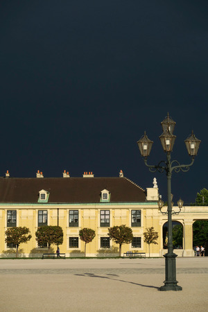 Dark sky still sunshine at the Schonbrunn park and castle Editorial