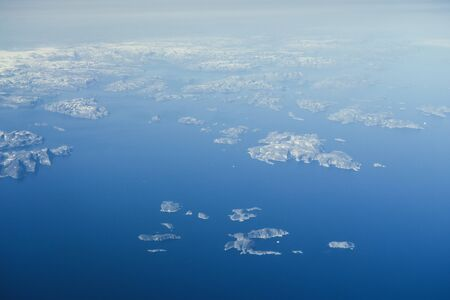 View on the flight from Europe to the USA, melting ice block and floe from greenland Stock Photo