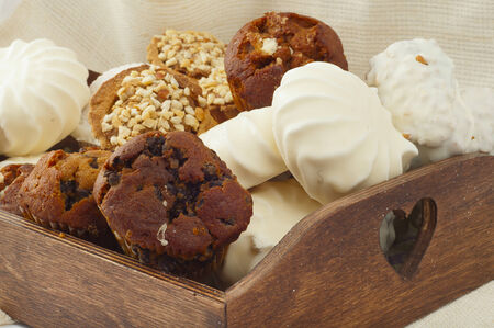 bad habit: appetizing mix of different Cake and marshmallows on wooden tray Stock Photo