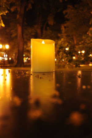 candle light: Burning candle on a table