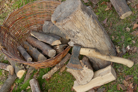 log basket: chopped firewood stacked in a basket with an ax