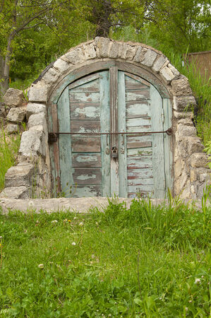 coquina: old cellar with old worn faded doors