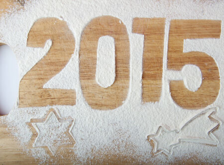 unusually: Decorative registration inscription 2015 made of flour on a wooden cutting board Stock Photo