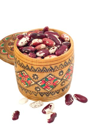 separately: white and red beans in a wooden barrel separately on a white