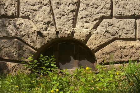 semicircular: window in the basement of an old house