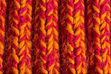 warm things: knitted orange-burgundy thing closeup