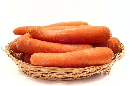 separately: raw carrots separately isolated in white