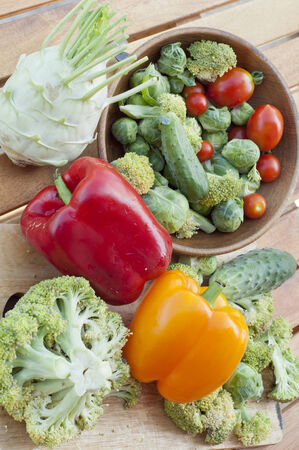 bell peppers: red and yellow bell peppers, cauliflower, tomatoes, cucumber with broccoli on the table Stock Photo