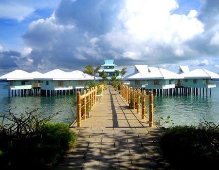 stilts: palawan philippines beach resort rooms on stilts on water  Stock Photo