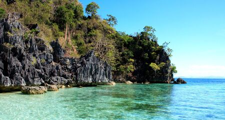 palawan: clear water beach with limestone rocks and white sand in palawan philippines