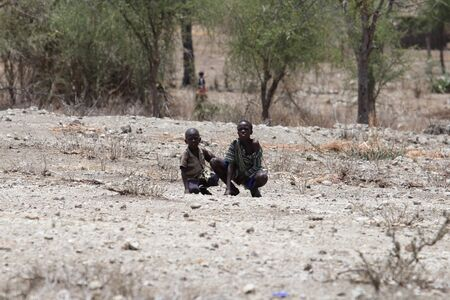 savanna: two children are observing in the savanna Editorial