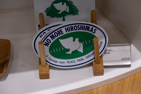 HIROSHIMA, JAPAN - FEB 05, 2018: Stickers of No More Hiroshimas with peace dove for sale in Memorial museum Sajtókép