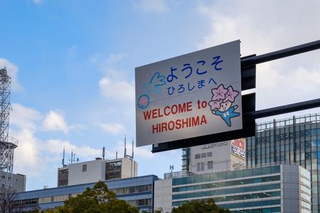 HIROSHIMA, JAPAN - FEB 05, 2018: Welcome to Hiroshima vial sign with kawaii character and blue sky