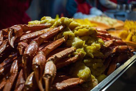 Crab legs sticks on street food market of China at night