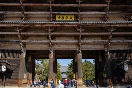 NARA, JAPAN - JAN 30, 2018: Tourists walking in entrance of Todaiji Nandaimon giant temple door in Nara Editorial
