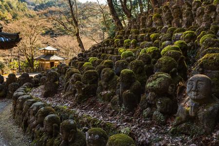 KYOTO, JAPAN - 07 FEB 2018: Kawaii little buddhas statues in Otagi Nenbutsu-ji temple in Kyoto