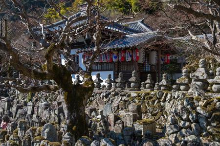 KYOTO, JAPAN - 07 FEB 2018: Temple building and statues of Adashino Nenbutsu-ji, near Arashiyama bamboo forest.