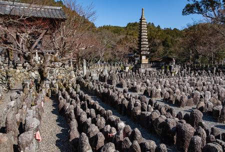 KYOTO, JAPAN - 07 FEB 2018: Pagoda, temple and many statues of Adashino Nenbutsu-ji, near Arashiyama bamboo forest. Editorial