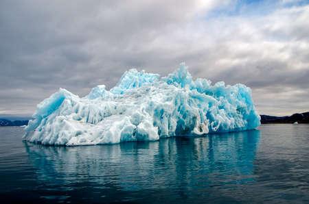 Bluish iceberg with beautiful shapes Stock Photo