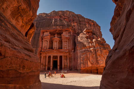 Facade of the treasury in the ancient city of Petra viewed from the canyon the Siq Stock Photo